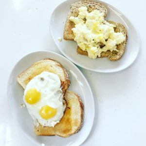 Fried and scrambled eggs on toast